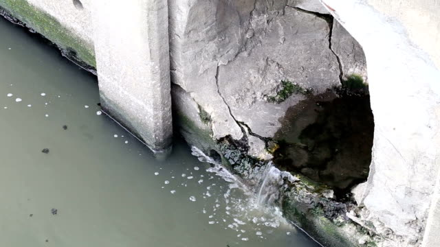 Sewer waste into the river video