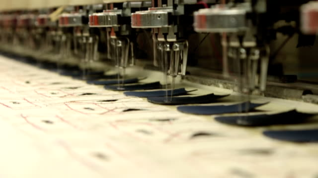 sewing and embroidery machine in slow motion video