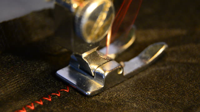 sewing machine, black clothing with a contrast red thread video