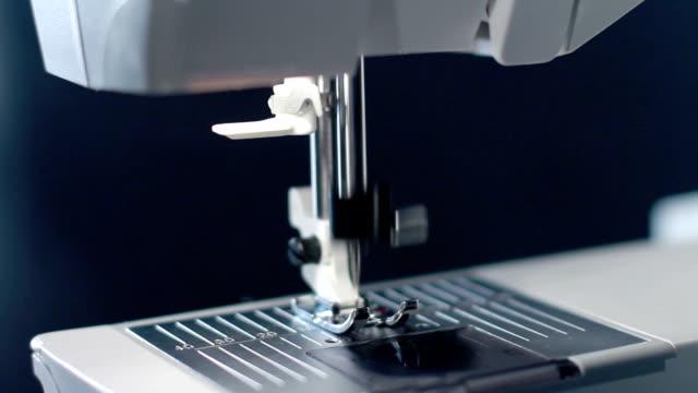 Sewing needle of modern sewing machine. Sewing machine needle work process video