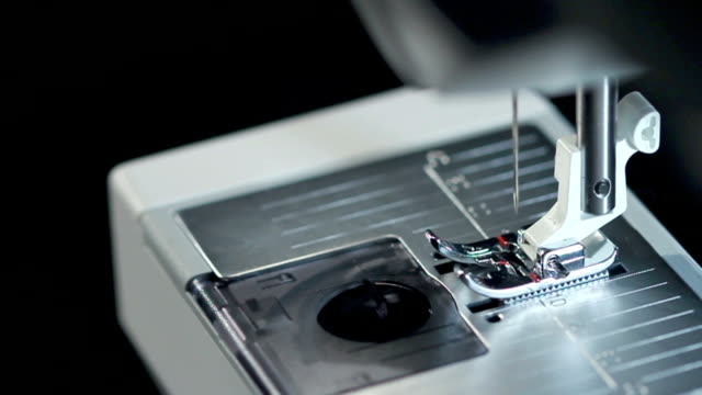 Sewing needle. Top view of working sewing machine in slow motion video