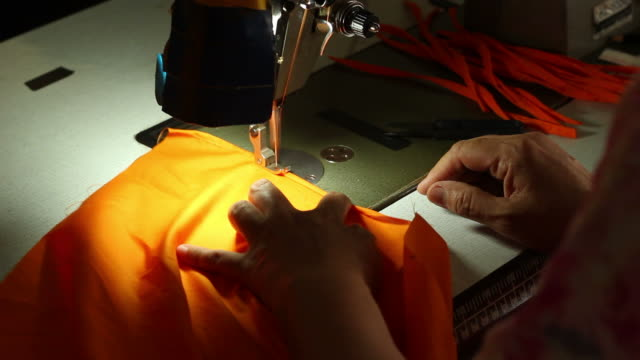 Sewing yellow costume. video