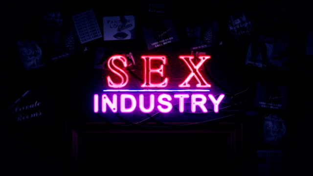 Sex Industry Neon Sign Turning On And Off Above A Door video