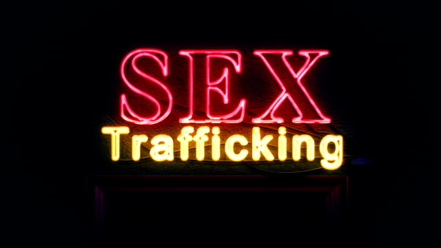 Sex Trafficking Neon Sign Turning on and Off video