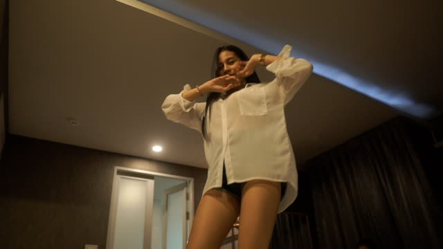 Sexy asian teenager girl enjoy dancing on the bed in hotel room video