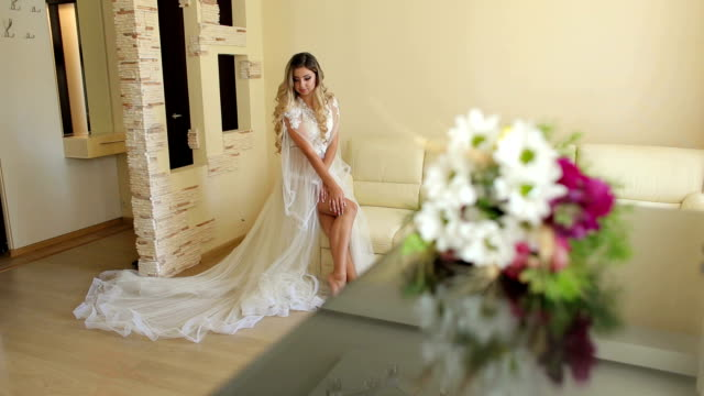 sexy bride in lingerie sitting on couch in morning - wedding fashion stock videos and b-roll footage