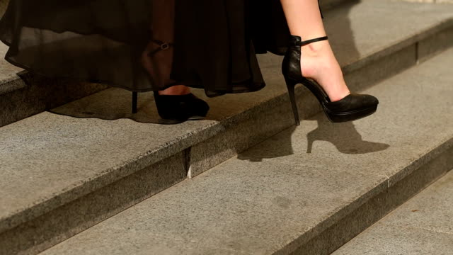 sexy legs in black high heels goes down the stairs - high heels stock videos & royalty-free footage