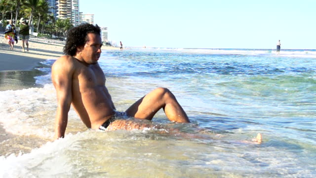 HD SUPER SLOW MO: Sexy Man Relaxing On Florida Beach video