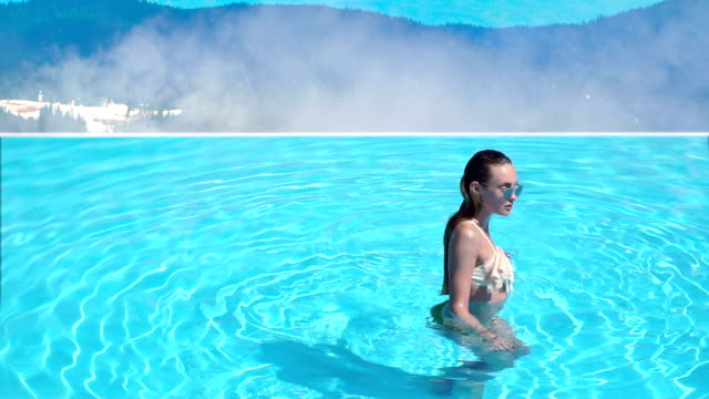 sexy wet young girl in the pool in the mountains video