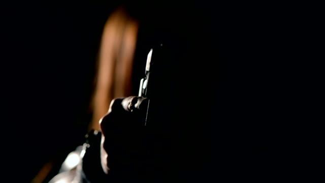 Sexy woman holding gun video