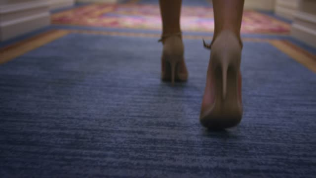 sexy woman in beige shoes walking on carpet floor back view - high heels stock videos & royalty-free footage