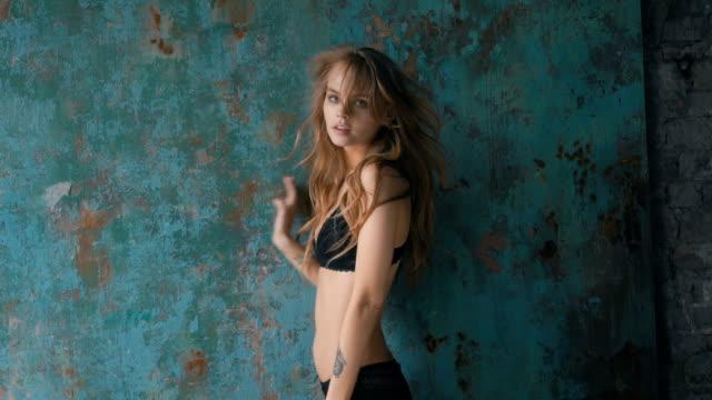 sexy woman in black lingerie posing near the wall - modelka i model filmów i materiałów b-roll