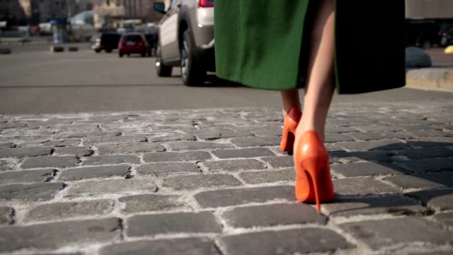 sexy woman legs walking on cobblestone street - shoes fashion stock videos and b-roll footage