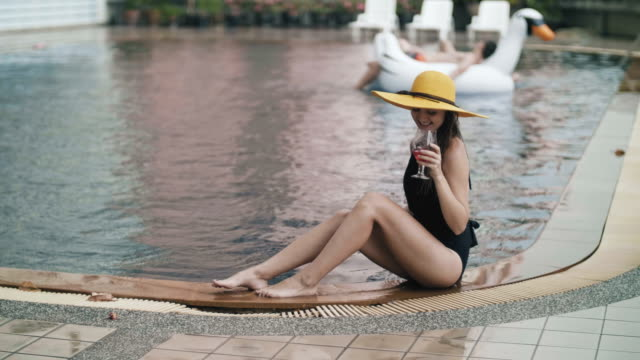 Sexy woman resting by poolside Sexy woman resting by poolside russian ethnicity stock videos & royalty-free footage