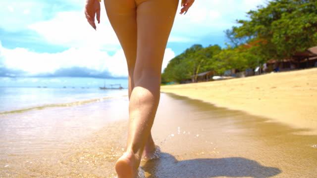 SLO MO Sexy Woman Walking Along Tropical Beach video