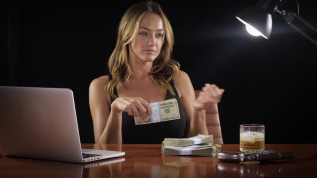 Video Sexy woman with a stack of money