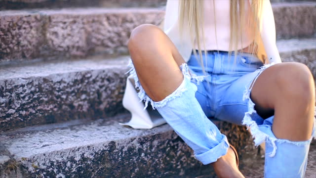 Sexy young stylish hipster woman posing video