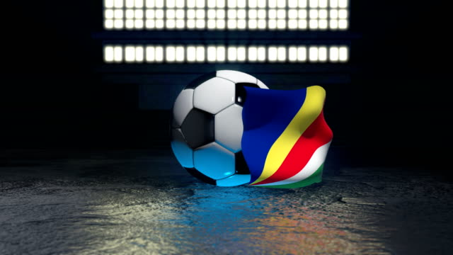 seychelles flag flies around a soccer ball - insygnia filmów i materiałów b-roll
