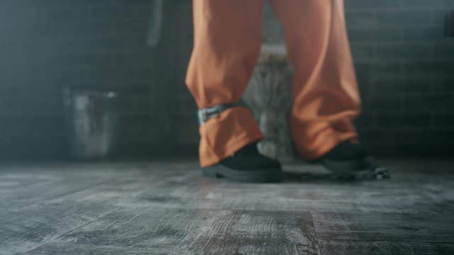 Shackles on legs of inmate video