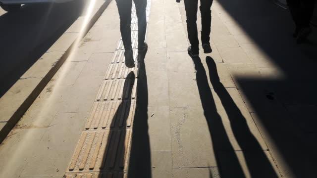 skuggan av en man på klappad trottoar - kontrastrik bildbanksvideor och videomaterial från bakom kulisserna