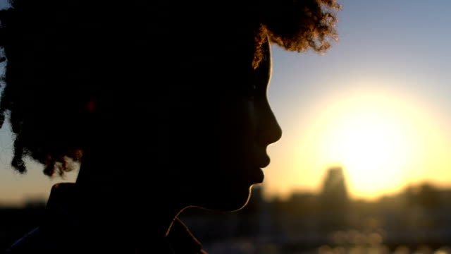 Shadow of sad lady looking at cityscape, saying goodbye to past life, sunset Shadow of sad lady looking at cityscape, saying goodbye to past life, sunset meditating stock videos & royalty-free footage