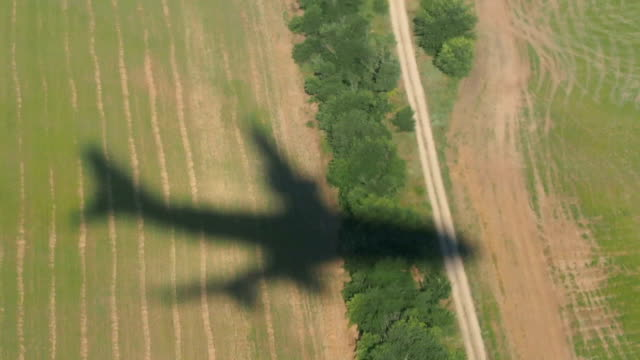 Shadow of the airplane moving down video