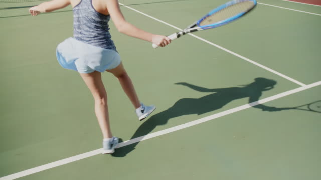 Shadow of young tennis player on court video