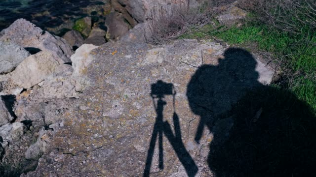 Shadow on the rocks from the photographer who takes the photo