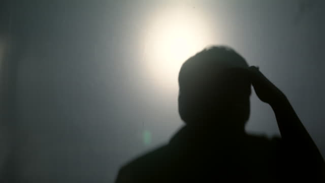 Shadowman looking from the dark