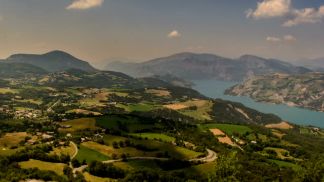 shadows moving over rolling landscape in haute provence alps gorges du verdon - barrage de serre poncon stock videos & royalty-free footage