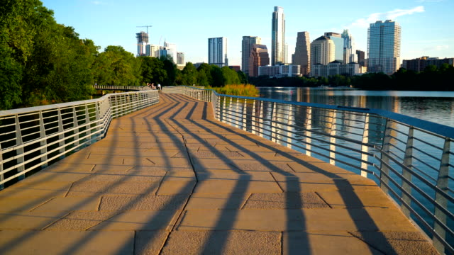 shadows of modern abstract view of the famous capital city - austin texas town lake reflection skyline cityscape - landmarks stock videos and b-roll footage