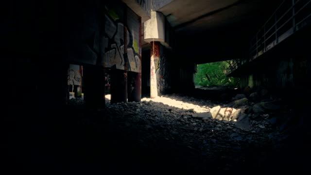 Shaft Of Light In Grungy Area Under Bridge