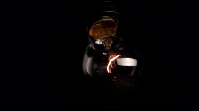Shaking bulb Shaking burning bulb tungsten image stock videos & royalty-free footage