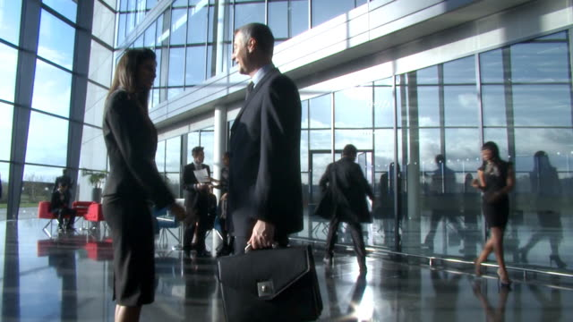 Shaking hands in large office environment  conference event stock videos & royalty-free footage