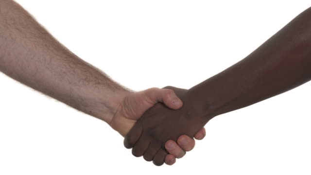 shaking hands of two male multiracial people. friendship among races concept - трясти стоковые видео и кадры b-roll