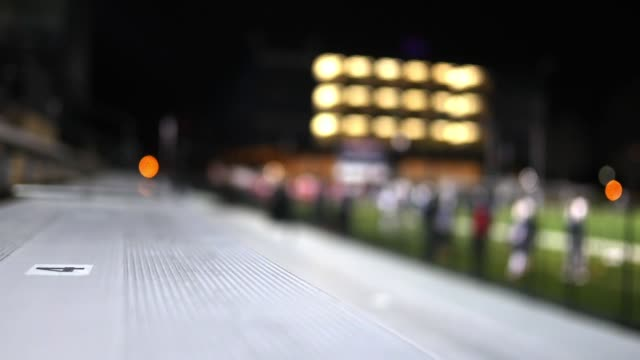 Shallow Depth of Field on Football Stadium Bleachers at night video