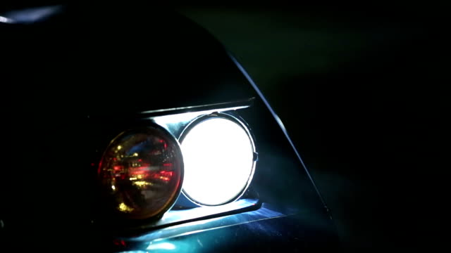 HD: Shallow focus on Corvette's lights at nigh time video
