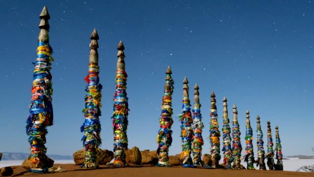 vídeos de stock e filmes b-roll de shaman pillars on the island of olkhon lake baikal. - irkutsk
