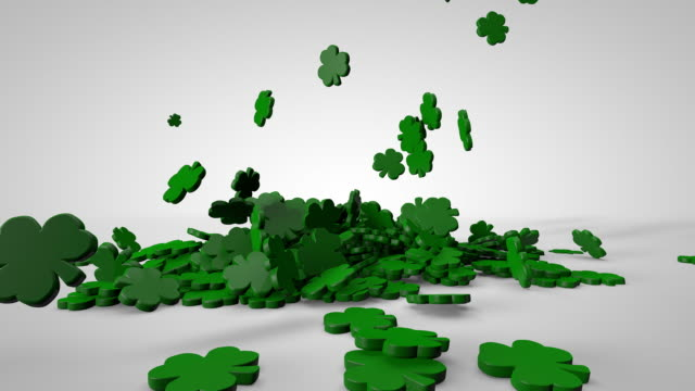 Shamrocks Falling on White A single small shamrock falls and is followed by many more. A large shamrock falls on to the pile at the end. shamrock stock videos & royalty-free footage