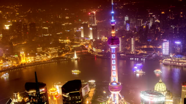 Shanghai at night, time lapse. Aerial view of high-rise buildings with Huangpu River in Shanghai, China. video