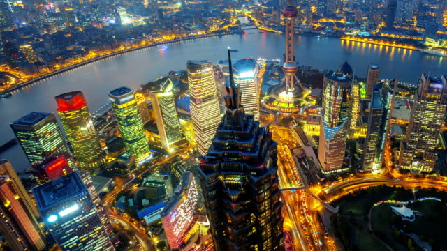 Shanghai at Night, Time Lapse(move up). HD: Aerial shot of high-rise buildings with Huang-Pu River in Shanghai, China.  shanghai stock videos & royalty-free footage