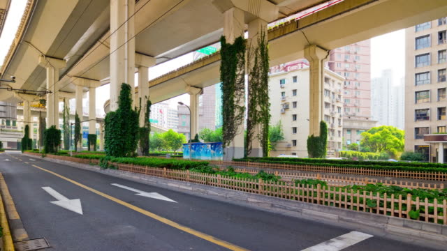 shanghai city day time traffic road junction side panorama 4k timelapse china video