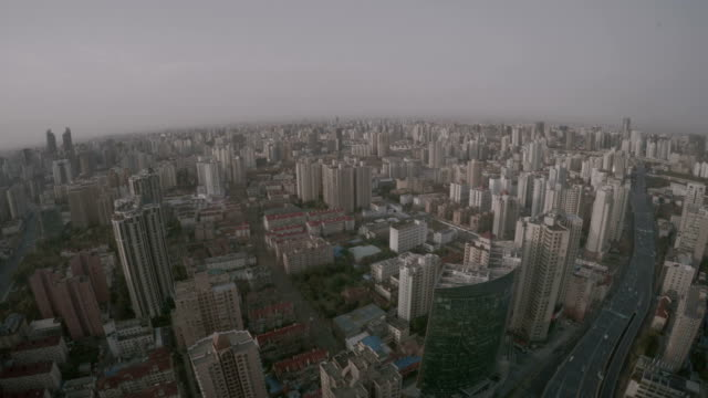 Shanghai cityscape buildings until the horizon. Endless urban sprawl as far as the eye can see in China. Typical part of the city with countless apartments and office buildings and highway with cars. wide angle stock videos & royalty-free footage