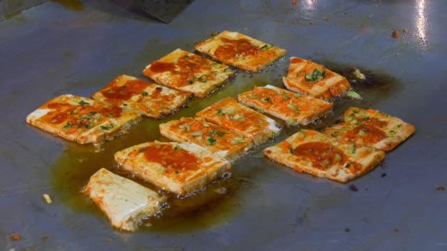 shanghai night time street food market tofu cheese hot pot 4k china video