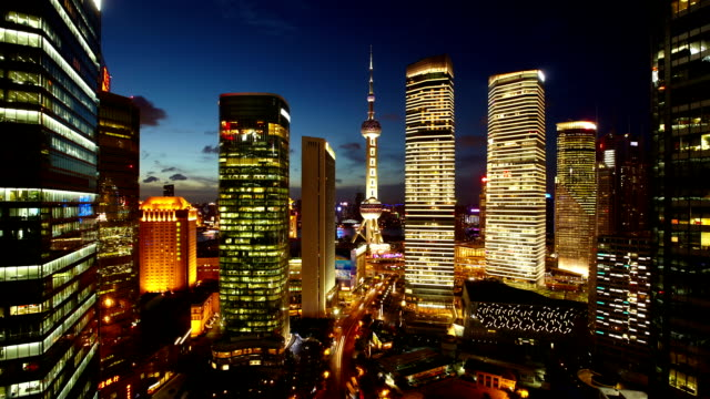 Shanghai Pearl Tower Timelapse Night timelapse of Pudong business district in Shanghai, China. View on multiple buildings and HuangPu river shanghai stock videos & royalty-free footage