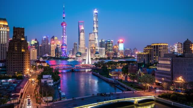 T/L WS HA Shanghai skyline dusk to night transition / Shanghai, China View of Shanghai skyline from dusk to night. shanghai stock videos & royalty-free footage