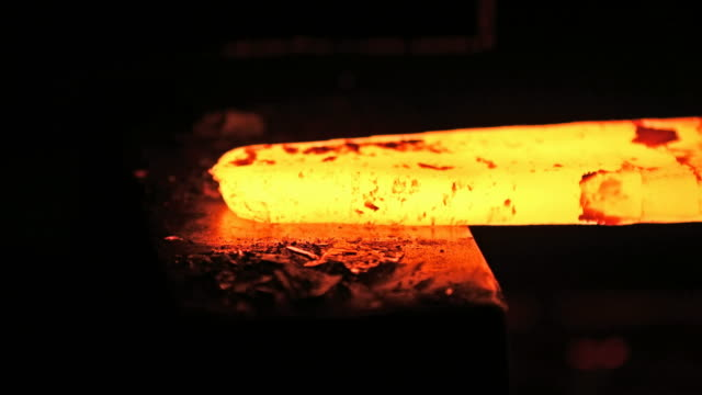 Shaping of metal part on a jackhammer in the blacksmith workshop