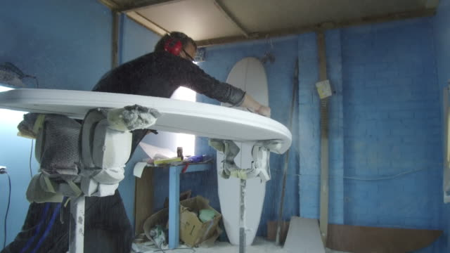 Shaping surf boards A man works in his workshop designing and shaping surf boards molding a shape stock videos & royalty-free footage