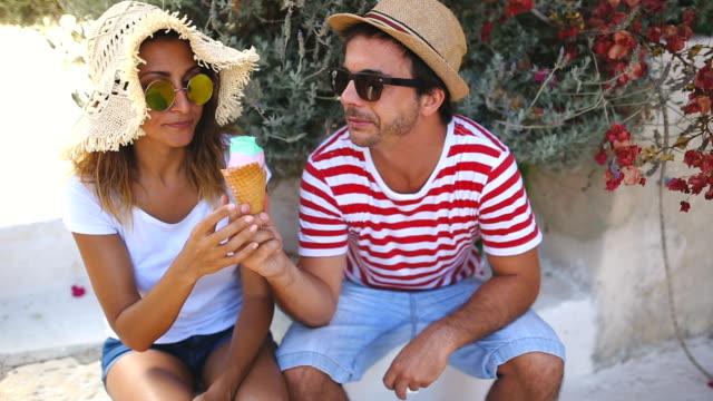 vídeos de stock, filmes e b-roll de compartilhando um sorvete - gelato