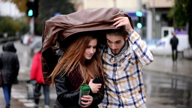 Sharing jacket Sharing jacket covering stock videos & royalty-free footage